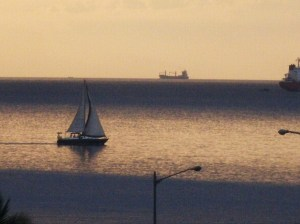 Boat sailing at sunset